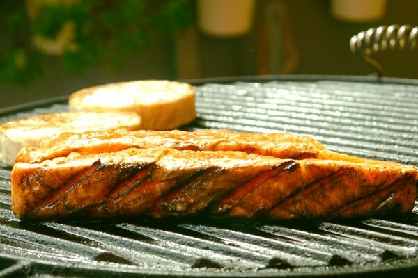 close up of meat on grill