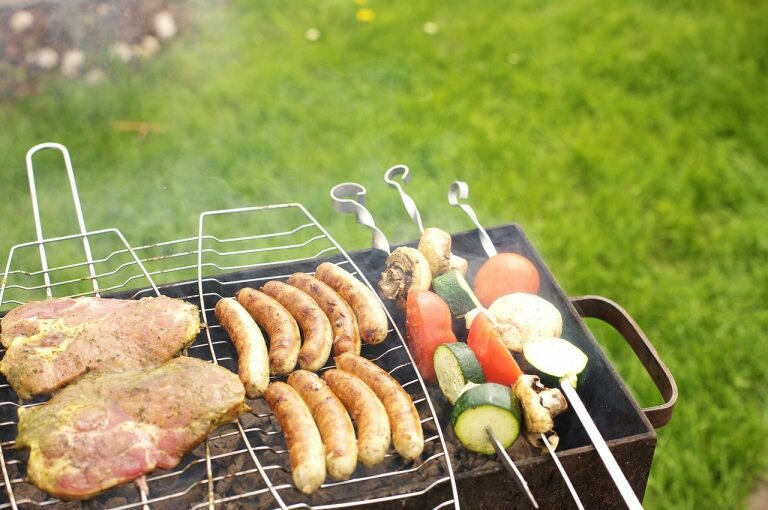 best portable charcoal grill barbecue-grill-spies-sausage-